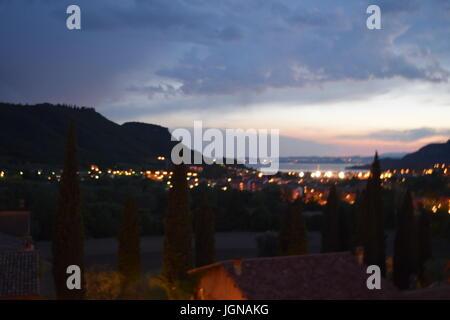 Gardasee bei Nacht, lake garda by night - Stock Photo