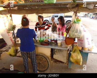 Street Vendor Push Cart Poipet Cambodia Decrepit Impoverished Town on the Thailand Border Line - Stock Photo