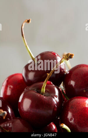delicious cherries in the foreground, on blurred background - Stock Photo