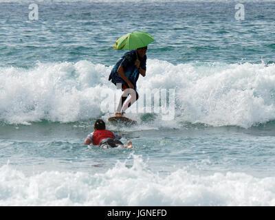 Surfing  fun fancy dress surfers - Stock Photo