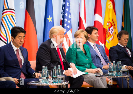 German Chancellor Angela Merkel, center, sits with U.S. President Donald Trump during the Women's Entrepreneurship - Stock Photo