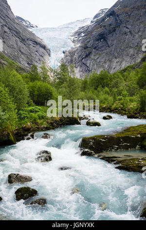View along river to Briksdalsbreen or Briksdal glacier arm of Jostedalsbreen glacier in Briksdalen in Jostedalsbreen - Stock Photo