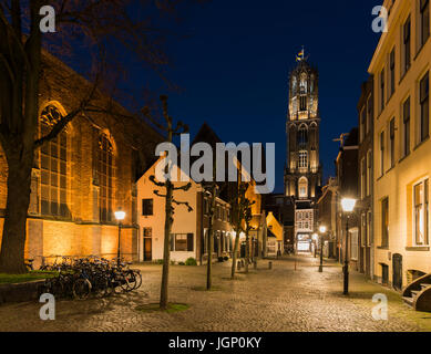 Utrecht, The Netherlands - March 27, 2017: Buurkerkhof at night with the Dom (church), bikes and  monumental houses. - Stock Photo