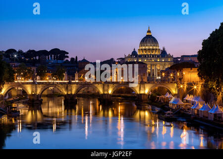 Saint Peter's Basilica with Sant'Angelo's bridge over Tiber at sunset, Rome, Italy - Stock Photo