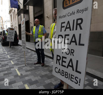 Cabbies protest outside the Cafe Royal Hotel wanting a fairer deal - Stock Photo