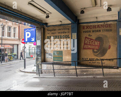 Old ghost signs for car parts in Soho, London - Stock Photo