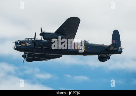 RAF BBMF Lancaster Bomber displaying new markings and nose art at Yeovilton Air Day, UK on the 8th July 2017. - Stock Photo