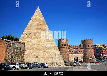 The Pyramid of Caius Cestius and the Saint Paul Gate ('Porta San Paolo'), Ostiense, Rome, Italy. - Stock Photo