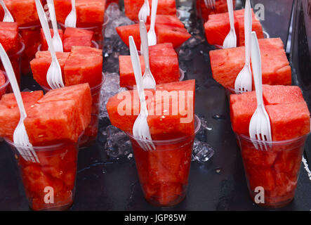 Pieces of watermelon in a plastic cup on a hot day - Stock Photo