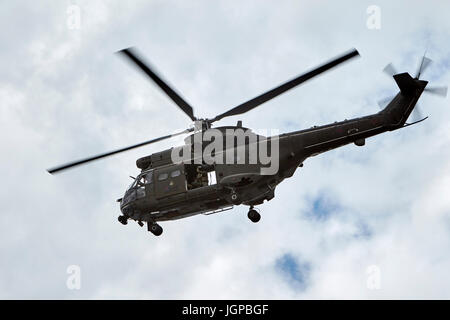 Royal Air Force XW209 westland puma helicopter with crew member waving uk - Stock Photo