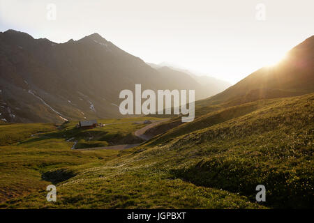 Late evening and the mountain hut on the french side of Col Agnel, Alps, france. - Stock Photo
