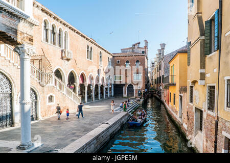 Venice, Veneto, Italy. May 21, 2017: Narrow channel next to the fish market near the street called 'de la Pescaria'