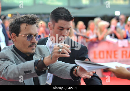 FILE - A file picture dated 19 July 2013 shows US actor Johnny Depp signing autographs during the premiere of his - Stock Photo