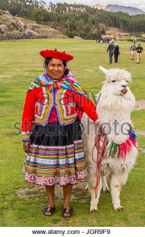 Mature Peru woman wearing traditional clothing and a hat with her llama at Sacsayhuaman near Cusco, Peru, South - Stock Photo