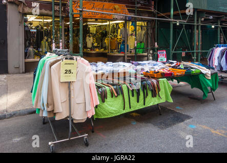 Men's budget clothing for sale on display outside a store on Orchard Street in the Lower East Side in New York City - Stock Photo