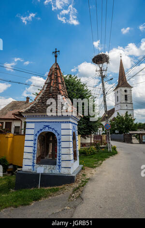 Small wayside shrine in Sibiel vilage famous from traditional Saxon architecture, Transylvania in Romania. Holy - Stock Photo
