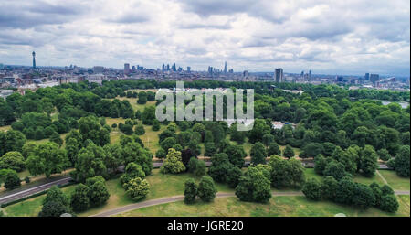 Aerial approaching view of central London over Hyde park - Stock Photo
