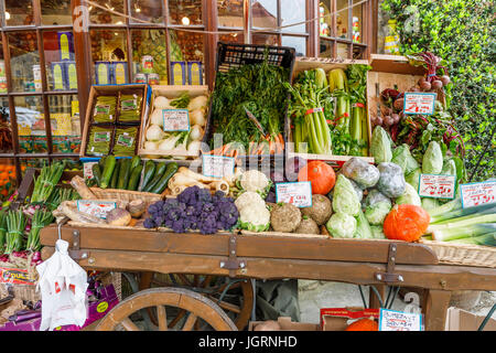 Colourful vegetable barrow display outside greengrocers shop, Broadway, Worcestershire, a beautiful village in the - Stock Photo