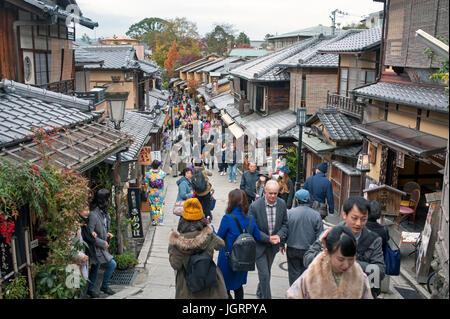 Kyoto, Japan - Tourists walking on a street leading to Yasaka pagoda - Stock Photo