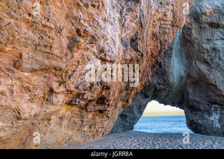 Hole In The Wall Beach at Sunset. - Stock Photo