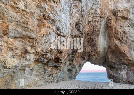 Hole In The Wall Beach at Dusk. - Stock Photo