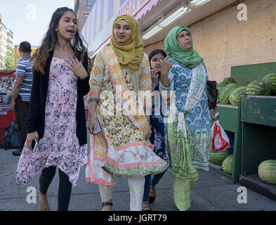 South Asian women walking on 73rd Street in Jackson Heights, Queens, New York City. Possibly a family. - Stock Photo