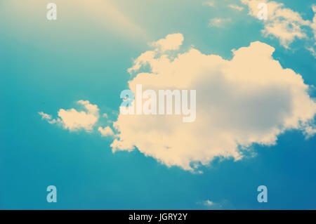 clouds in vintage style. sky with clouds Stylized under the old photographs. The sun is bright shining blue through - Stock Photo