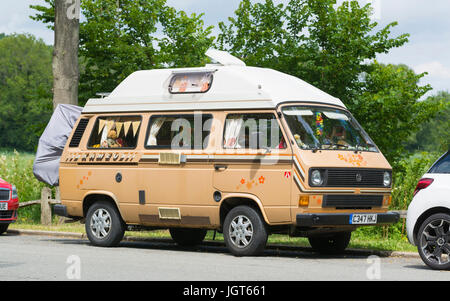 Old Volkswagen Transporter van parked by the side of the road. - Stock Photo