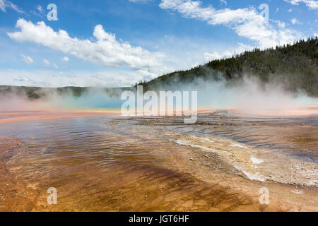 Grand Prismatic Spring covered in steam on a cold windy but sunny day. Midway Geyser Basin, Yellowstone National Park Stock Photo