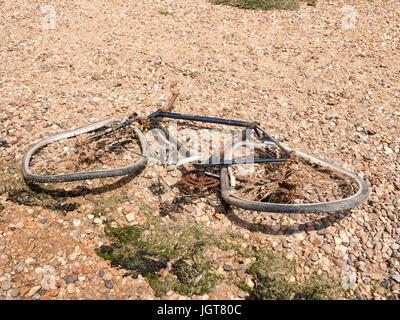 Rusty Broken Bike Discarded on the Beach; Essex; UK - Stock Photo