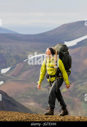 Young woman hiking in Iceland - Stock Photo