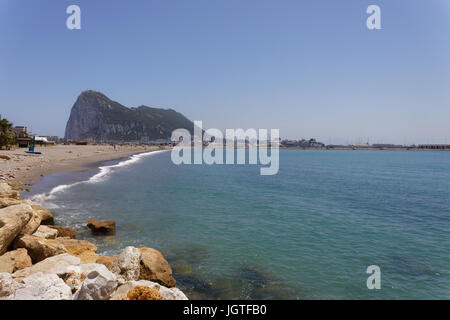 Gibraltar's famous Rock, seen from La Linea in Spain - Stock Photo