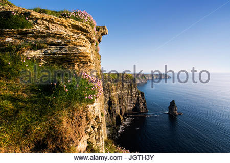 Sunlight shines on the Cliffs of Moher. - Stock Photo
