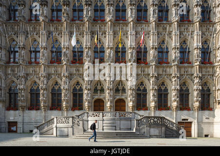 Leuven Town Hall (Stadhuis), Belgium, an ornate 15th-century medieval building with extensive sculpture and pinnacles. - Stock Photo
