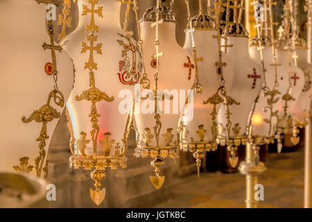 Decorated lanterns above the Stone of Unction in the Church of the Holy Sepulchre, Old City of Jerusalem, Israel. - Stock Photo
