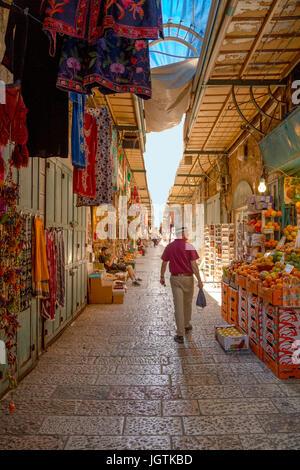 Bustling commercial life at the Via Dolorosa, Old City of Jerusalem, Israel. The Via Dolorosa marks the last steps - Stock Photo