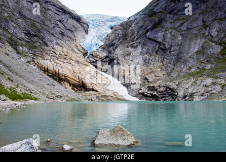Briksdalsbreen or Briksdal glacier is an arm of Jostedalsbreen glacier above Briksdalsbrevatnet glacial lake in - Stock Photo