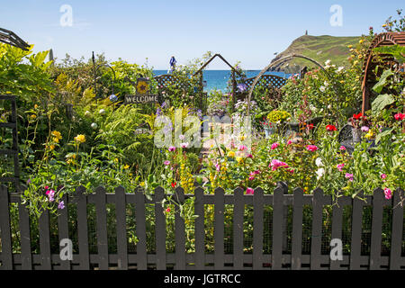 A garden full of flowers over looking the beach at Port Erin on The Isle of man. - Stock Photo
