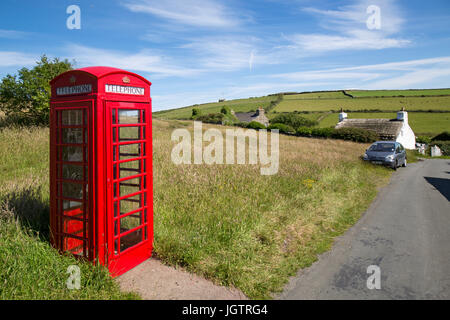 British red telephone box in the village of Cregneash on The Isle of Man. - Stock Photo