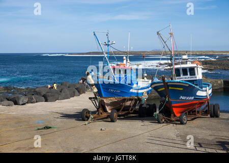 Two fishing boats on trailer at the harbour slip, village La Santa at north coast of Lanzarote island, Canary islands, - Stock Photo