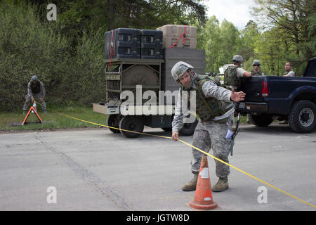 A Silver Flag instructor trains Airmen on the proper measurements during airfield damage repair at Ramstein Air - Stock Photo