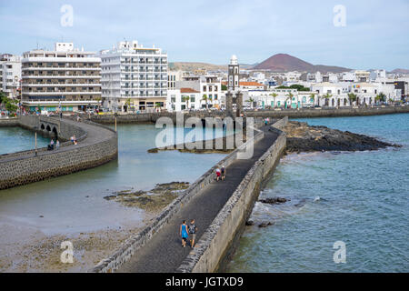 Pedestrian dam connects city of Arrecife with fortress Castillo de San Gabriel, Arrecife, Lanzarote island, Canary - Stock Photo