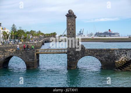 Drawbridge Puente de las Bolas (Bowl bridge), connect Arrecife with fortress Castillo de San Gabriel, Arrecife, - Stock Photo