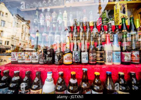 ANTWERPEN, BELGIUM - June 02, 2017: Different belgian beer bottles on the showcase in Antwerpen city - Stock Photo