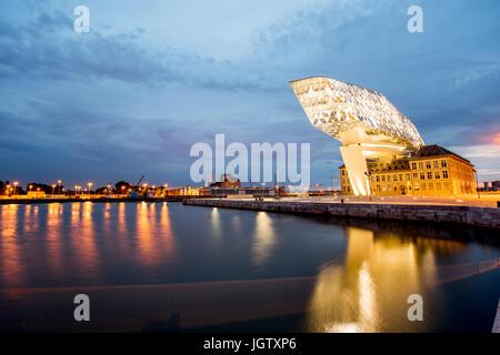 ANTWERPEN, BELGIUM - June 02, 2017: Night view on the illuminated Port House building designed by Zaha Hadid architect - Stock Photo