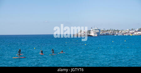 Stand-up Paddling at Playa Blanca, Lanzarote island, Canary islands, Spain, Europe - Stock Photo