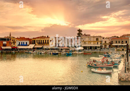 Rethymno old port with bars and restaurants lit with warm sunlight, Crete, Greece - Stock Photo