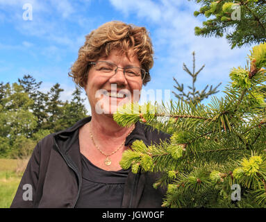 Laura Waters at her shop, Snowdon House outside Victoria, BC, Canada on Vancouver Island, where she sells edibles - Stock Photo