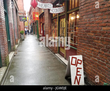Fan Tan Alley, originally Victoria Chinatown's opium den and center of gambling. Now it's lined with tourist shops. - Stock Photo