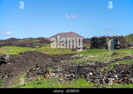 Tiny country house built with lava stones at the fishing village El Golfo, Lanzarote island, Canary islands, Spain, - Stock Photo